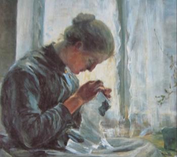 細かい作業をしている年老いた女性